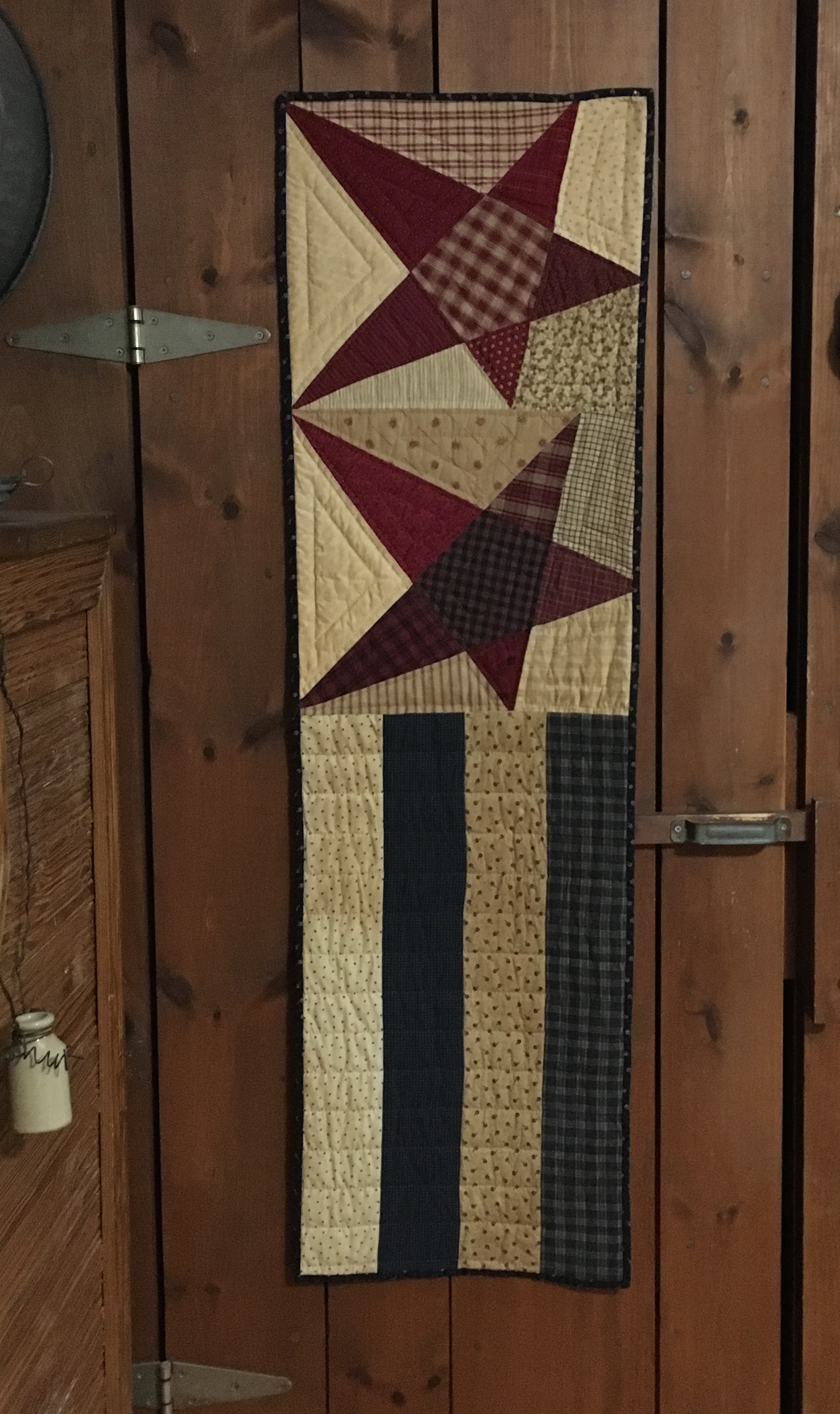 Pieced fabric and applique star flag door hanger