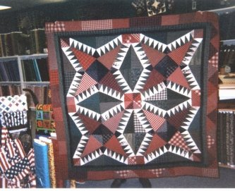 "Annie Woods, owner of Quiltmakerss Workshop in Alabama, made this version of ""Fiddlin Around"". She used this quilt for a Christmas Mystery quilt. Great Job!"