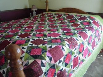 "Barb Redinger from Chattaroy, WA made The Hat Ladies to fit her ""California King"" sized bed. She said it took her 10 weeks to make. She did say she didn't work on it 24-7, but sounds like she's delighted it all DONE! lol Thanks so much Barb for sharing yo"
