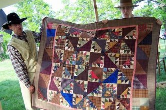 "Angie sent me this picture of her wonderful ""Barnabus Barnsmell"" along with this note My husband and I are Civil War Re-enactors and I gave the quilt to one of the gentlemen of the group. He loved it. In the picture with the 2 men holding the quilt the yo"