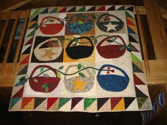 Carol Edwards made this charming Slim Pickins Quilt....very bright and cheerful! Thanks Carol (The back of Carol's quilt can be seen on the Back Porch page)