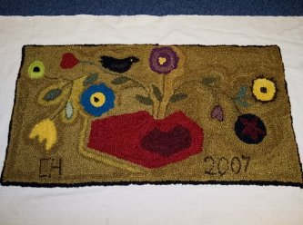 """Cathy Hansen from Ohio sent me a picture of her """"My Special Valentine"""" wool punched rug. This was a class at PMW this year in Missouri. Great job Cathy! Thanks for sharing."""