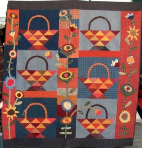 """Charlene Higgins made this wonderful """"A Tisket A Tasket, Aunt Roma's Garden Basket"""" quilt. You did a great job Charlene. You can see the back of Charlene's quilt on the Back Porch page...Thanks so much for sharing with us!"""