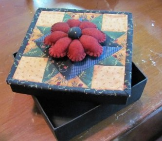"Charlene Higgins made the sewing box from the ""Funda Bundle"" pattern. She used wool for the pin cushion. It turned out wonderful Charlene."