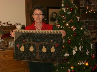 """Charlene Neufield sent me this picture of her """"Two Pair"""" table rug. It was in the American Patchwork and Quilting Magazine last year and they retitled it """"Perfectly Perched"""" for the magazine article. I taught this class at PMW in Missour. Great job Charle"""