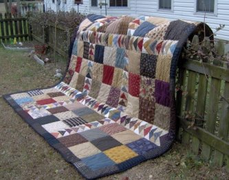 """Cheryl Mills made her daughter this nine patch geese quilt from the """"My Yesteryear Collection"""" for Christmas. Her daughter wanted it to look and feel like a comforter so Cheryl used a high loft batting. What a wonderful job. Did you say it's for a king si"""