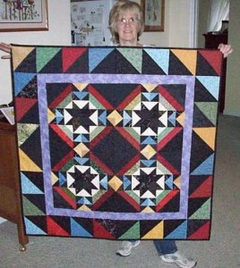 Chris Gerhardt did a wonderful job on her Burning the Midnight Oil Quilt. Thanks Chris for sharing the quilt and a lovely picture of you too!