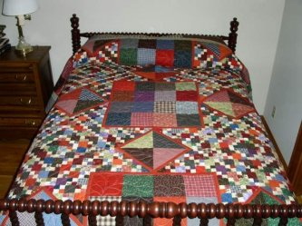Debby put her Moonshine Quilt on this wonderful spindle bed to show it off. Thanks so much for sharing this larger version of a fun quilt to make.
