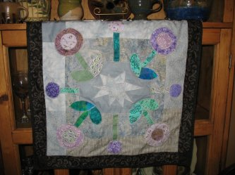 Debi George from Troy Missouri sent me this version of The Bundling Board....here's what she had to say This is my second attempt at quilting (my first was a t-shirt quilt) and I'm thrilled with the results. I chose fabric in the colors of my best friend'