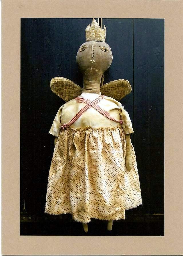 Queen Doll on Black Cupboard