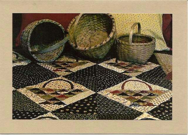 baskets on bed with gathering baskets quilt