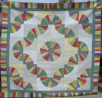 I'm always delighted when someone makes a quilt from one of my patterns and does it totally different. I love Jeanne's Fanshawe Dam done in lighter colors.........looks like spring to me. I love it.