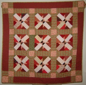 Jeanne Arnieri sent me this picture of her Let's Play Jacks quilt from the Primitive Youngins book...she calls it Appleseed because of the black triangles in the center. How fun is that? Great job Jeanne!-parlor, jeanne arnieri, lets play jacks