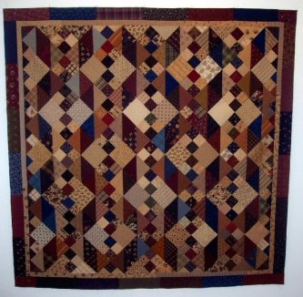 Jeanne Wortham from Melbourne has done it again! This is her Last Wrung on the Ladder. Jeanne says she used up bunches of her scraps to make this quilt.....it's wonderful! Thanks Jeanne