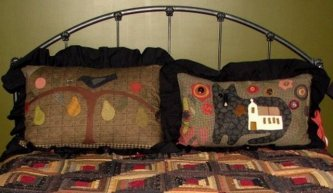"Linda Poe is so creative. She sent me this picture of her bed where she made ""Perfectly Perched"" for one pillow case and another design for the other. What a wonderful idea linda! ""Perfectly Perched"" was a table rug I designed for American Patchwork and Q"