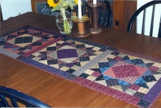 Lisa from California took a class from me a few years ago at PMW and sent me this picture of the Primitive Sketches table runner she finished. Lisa, it looks beautiful on your new table! Thanks for sharing.-parlor, Lisa from California, Primitive Sketches