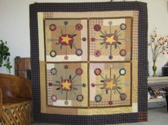 "LuAnne Leonard sent me this picture of her ""Bundling Board"" quilt. LuAnne said it took her 3 years to finish hand quilting her quilt, but it was worth every stitch. Thanks so much for sharing with us LuAnne...Great job! You can see the fun back she made o"
