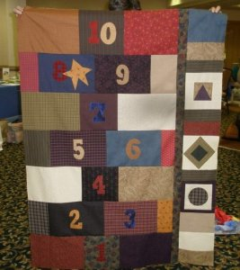 Lynn Ray from Illinois is the first to send me a picture of HOPSCOTCH....a quilt in the new Primitive Youngins book! GREAT JOB Lynn! Now, who are you going to play with?