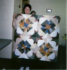 From Quiltmaker's Workshop a picture of Forever Friends made with civil war prints.