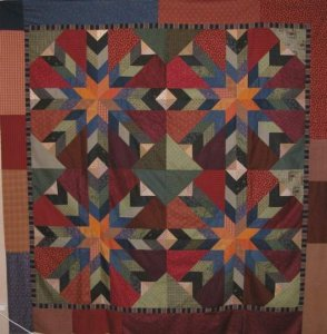 Raedene Frost from Brandon, Fla. sent me a picture of her SHOTGUN WEDDING quilt top. She was in the class that I taught down in Brandon, Fla. this July. What a wonderful job! Thanks for sharing Raedene.