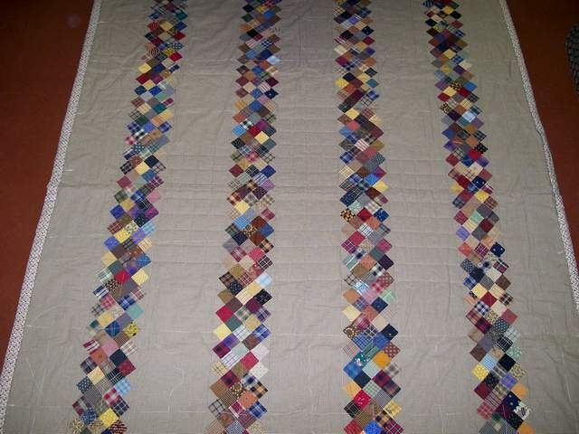 pieced strip quilt, partially hand quilted