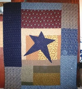 "Susie also has made two of the three quilts in the ""My Yesteryear Collection"" booklet. The star, which is shown here............was pieced by her and quilted by Beth Bogner."